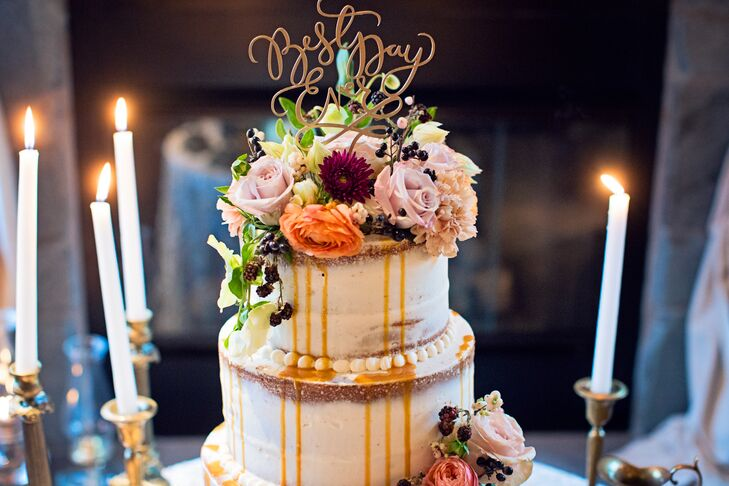Guests indulged in a nearly naked caramel apple wedding cake topped with autumn-inspired florals and a sweet drizzle of caramel.