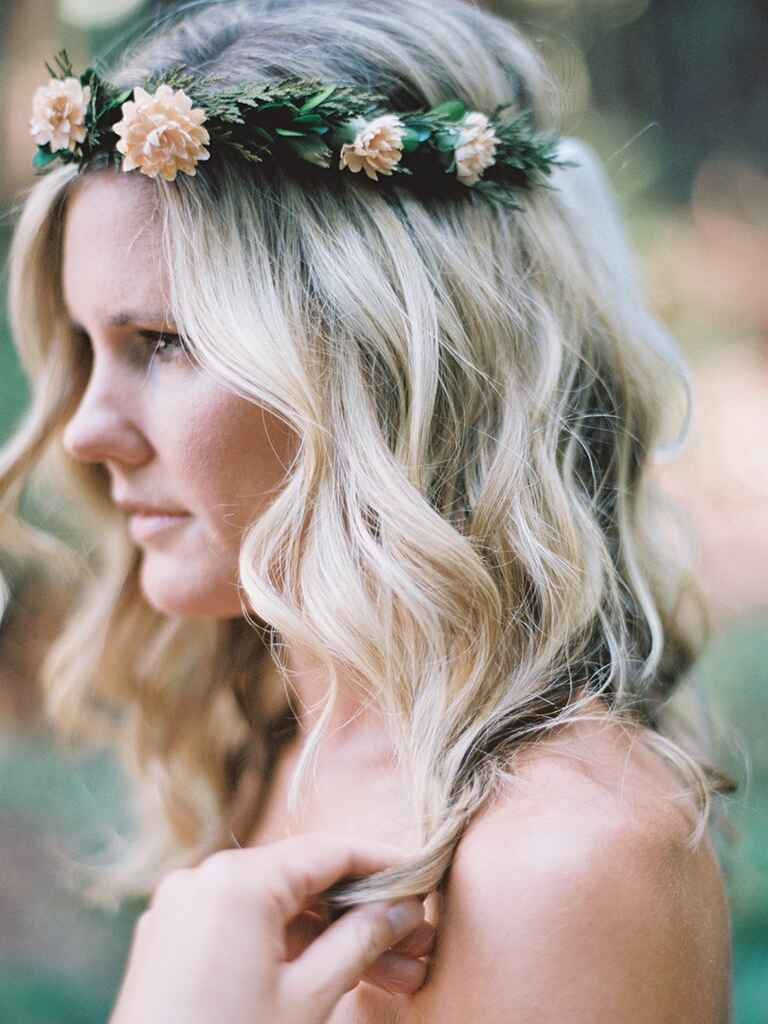 Wedding hairstyle curly down with flowers