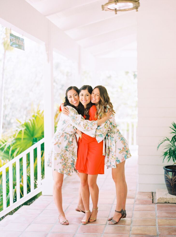 Francesca's bridesmaids matched outfits even before the ceremony. They picked out these floral print robes, strappy sandals and down curled hairstyles for the morning.