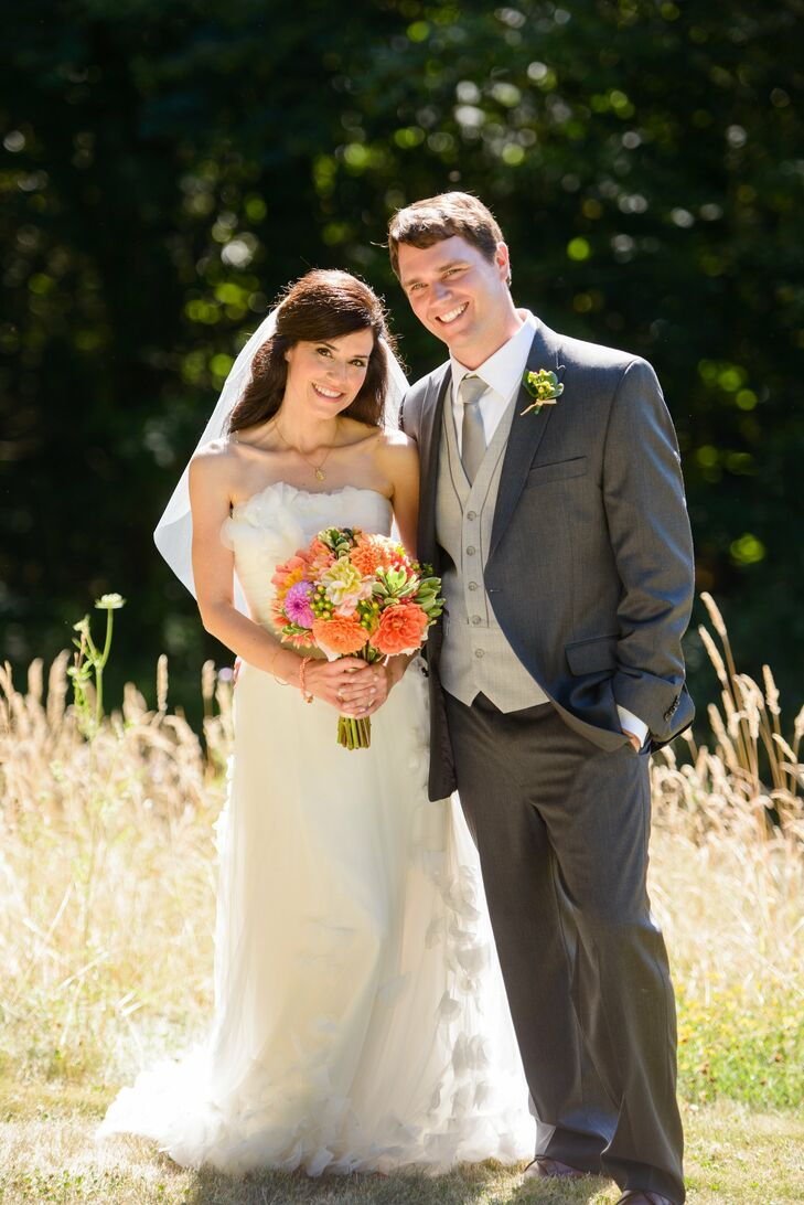 Megan and Mike wore updated classic styles for an elegant, sophisticated look. Megan wore a strapless A-line gown with romantic draped bodice and petal accented sheer organza overlay. Mike wore a dapper three-piece suit in two shades of gray.