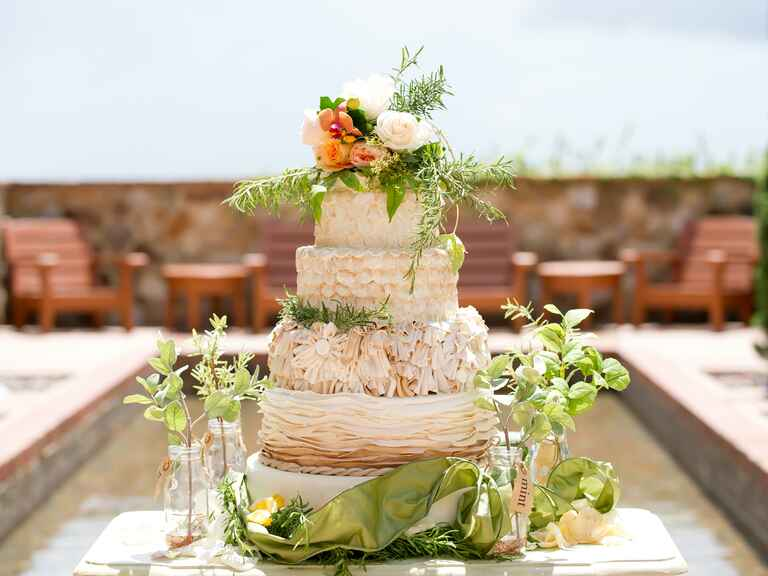 Tiered rustic wedding cake with natural greenery