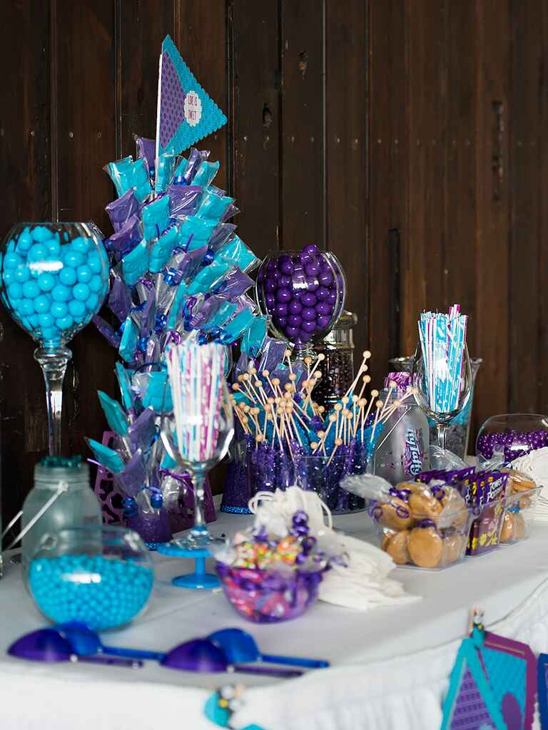 Purple and blue themed wedding reception candy bar