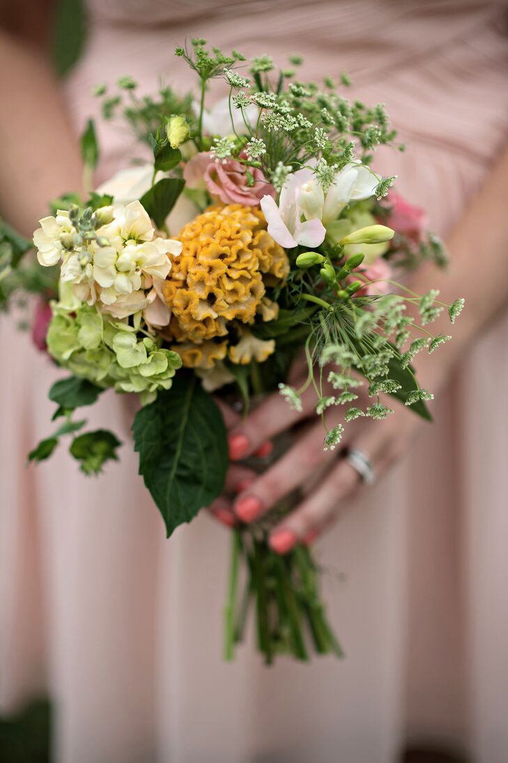 A Peach, Gold, and Green Bridesmaid Bouquet with Garden Roses, Freesias, and Hydrangeas