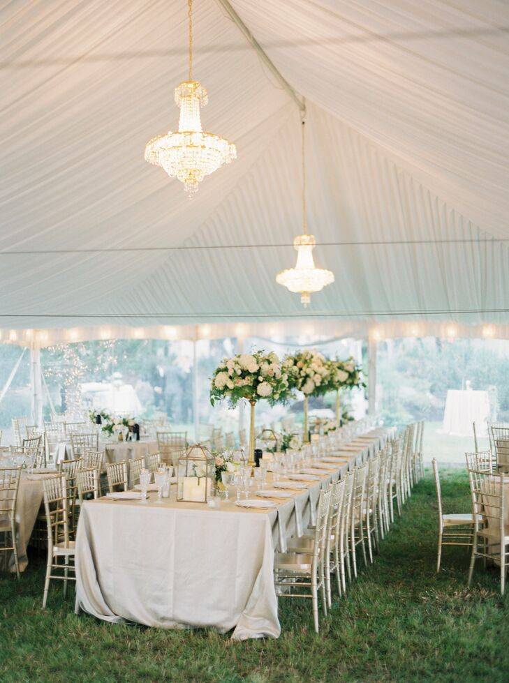 Chandeliers, lights, linens and floral centerpieces added a sophisticated feel to the tent's interior.