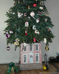cecilie starin an interior designer in san francisco used an old french inspired dollhouse as a tree stand for a playful touch - Designer Christmas Tree