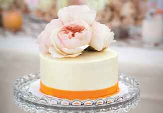 simple white orange cake | Michael Segal Photography | blog.theknot.com