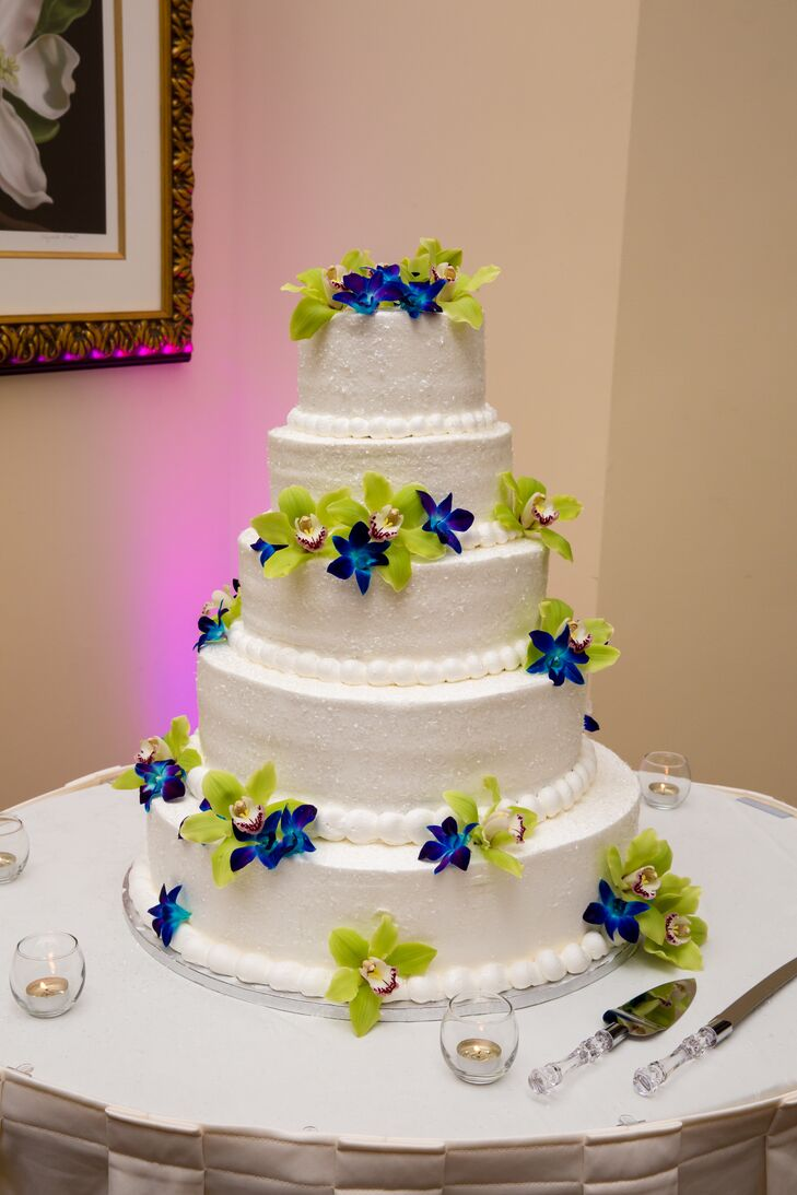 Glittery White Wedding Cake With Fresh Blue and Green Orchids