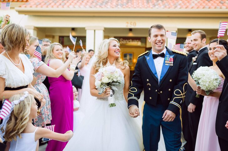 The couple exited their ceremony to guests waving tiny American flags.