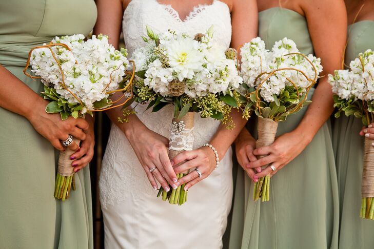 The bride and her bridesmaids held white hydrangea and peony arrangements with green accents, all tied with burlap. The bridesmaids wore green dresses by Alfred Angelo.