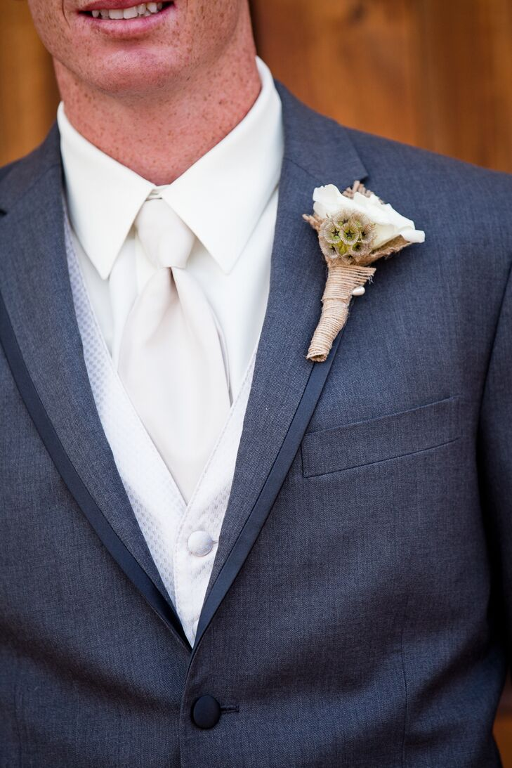 Dustin had a boutonniere wrapped with burlap pinned to his charcoal gray tuxedo from Men's Warehouse.