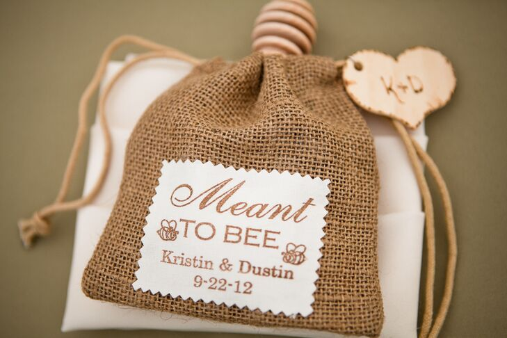 Guests were given jarred honey wedding favors at the celebration, wrapped in burlap bags that fit the theme of the wedding.
