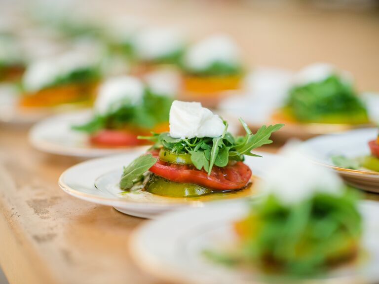 Tomato arugula salad on a white plate