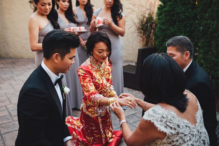 """My favorite detail was the traditional tea ceremony that took place immediately after the ceremony,"" Yan says. After exchanging vows, Yan and Stephen gathered with their closest family members at the arbor to perform the traditional Chinese custom. ""Serving tea to your new family is a symbol of respect and love, and in return they welcome you by giving you jewelery, which often includes family heirlooms,"" Yan says. ""I appreciated this part of the wedding the most because it represented my culture and roots—it's something I've dreamed of doing since I was a kid."""