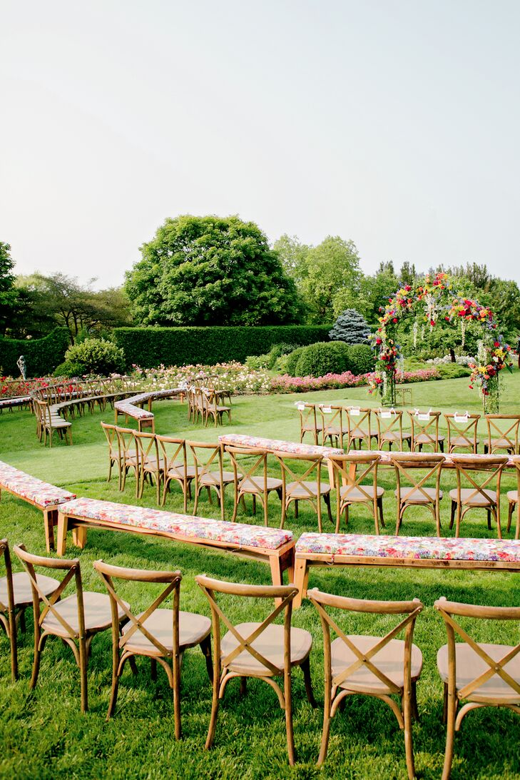 "A wrought-iron arch covered in seasonal blooms became the focal point of the rose garden at Chicago Botanic Garden for Maggie and Joe's vows. Guests sat in a semicircle of French country chairs and vintage wooden benches as Maggie walked in to a saxophone rendition of Ed Sheeran's ""Thinking Out Loud,"" played by Joe's brother, Max."