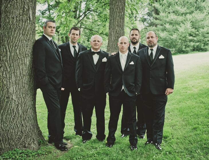 With a formal theme, Andy and his groomsmen wore black slim-fit tuxedos.