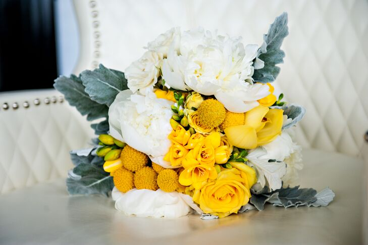 Unfortunately, because their wedding fell on a hot summer day, many of Nicole and Nicolas' flowers (arranged by Joanne Nikitas Creative Floral Design) wilted. Luckily, Nicole's beautiful bouquet of white and yellow roses, peonies and craspedia remained vibrant, adding pops of color to the gray wedding fashions.