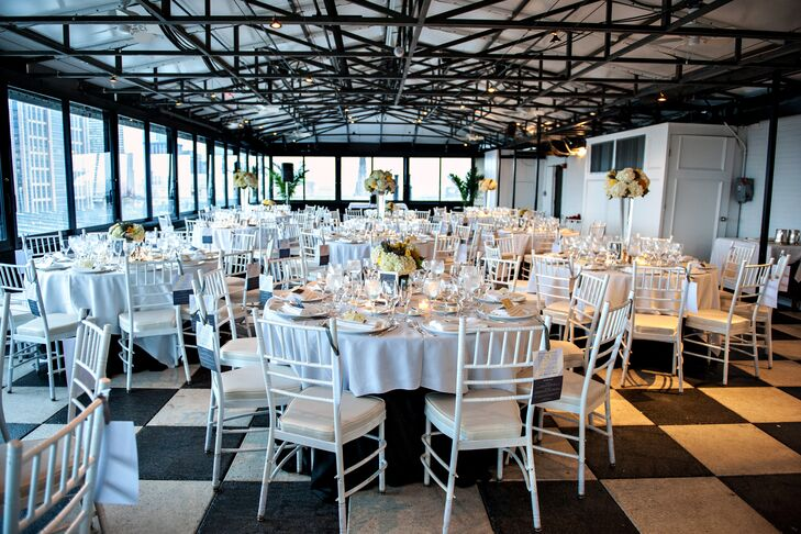 "Nicole and Nicolas' wedding reception space at the Taj Boston included wide windows that overlooked Boston Gardens, providing guests with beautiful natural scenery. They decided to keep their decor crisp and modern. ""I wanted things streamlined and clean,"" Nicole says, ""and a little more on the modern side."""