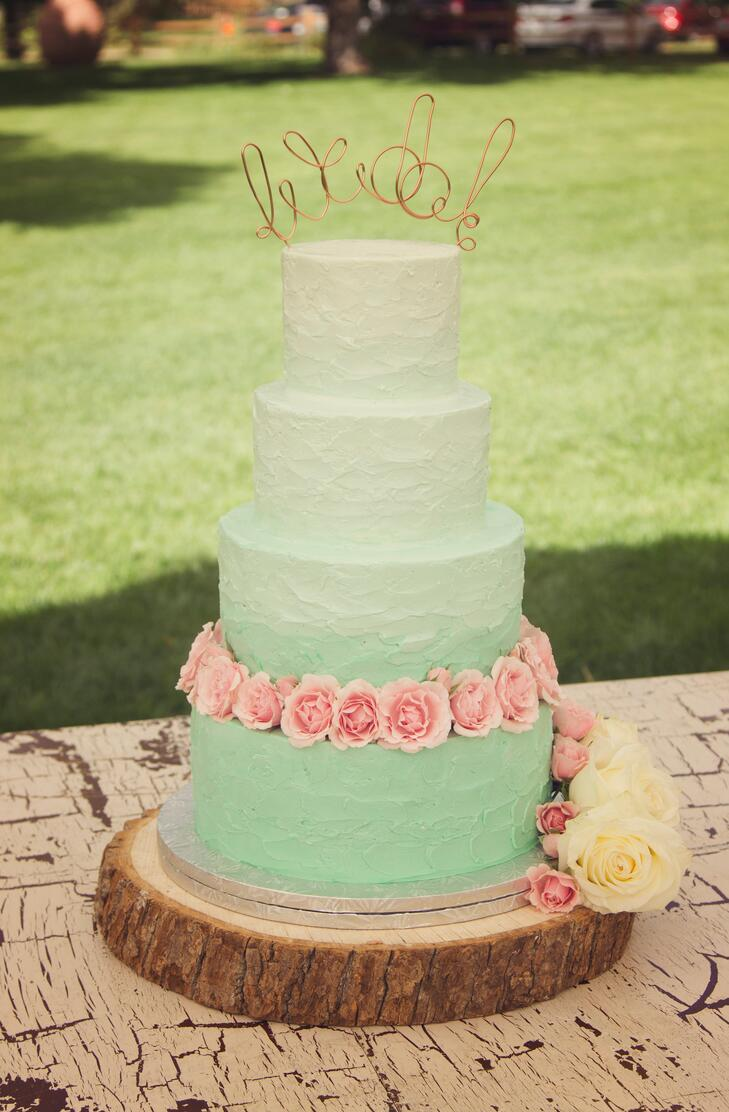Five Tier Green Round Wedding Cake Decorated With Small And Large White Pink Cherry Blossoms The Are Handmade Gum Paste They