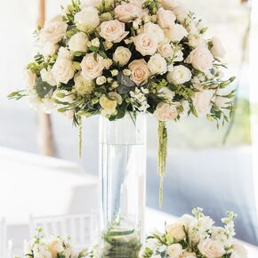 White wedding centerpieces elegant high and low centerpieces with white blossoms mightylinksfo Images