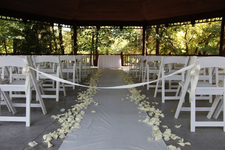 Whitney and Adam exchanged vows in the onsite gazebo. The aisle was decorated with fresh white rose petals.