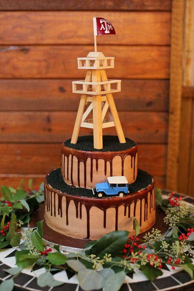 The groom's cake was a two tier red velvet cake with a miniature Land Cruiser and oil derrick with a Texas A&M University flag, reflecting the groom's interests.