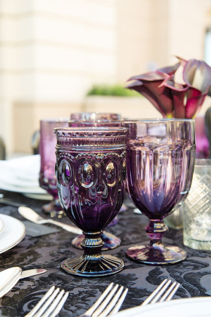 Florist R Jack Balthazar placed white bouquets and intense purple lisianthus atop the long banquet table alongside textured mercury-glass votives and vases.
