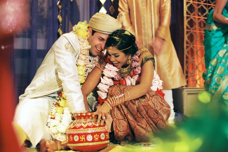 Naina and Scott showered each other in rice at the traditional South Indian ceremony in the morning. Other traditions at their first ceremony included the ring game and taking seven steps together as husband and wife.