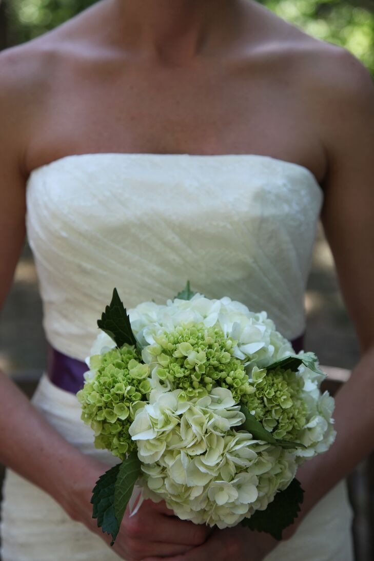 The bride carried a simple green and white lady's mantle and hydrangea bouquet.