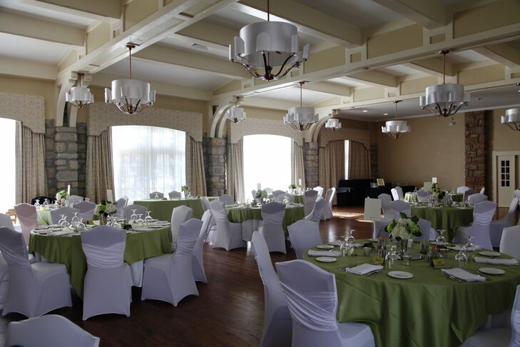 """The hotel had a historic feel with modern updates,"" Whitney says. ""It had the perfect room for our dinner and reception."" The couple decorated the room with green and white linens."