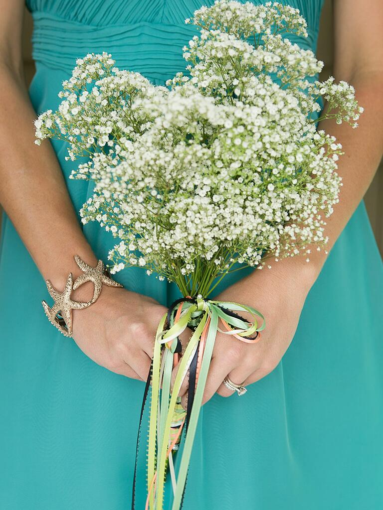 Unique wedding bouquet idea with baby's breath and a ribbon wrap