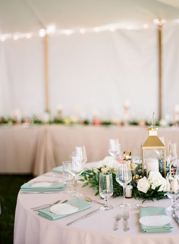 """We kept our flowers very simple since our location was so beautiful and lush,"" Jamie says. ""We used lots of garlands with pops of pink peonies—my favorite flowers—and peach garden roses."" The tablescapes also included gold lanterns, pillar candles and rose gold votives."