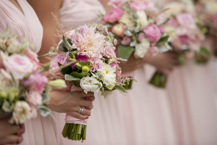The bridesmaids bouquets were bolder than my bouquet, filled with a mix of peach garden roses, pale pink spray roses, light and medium pink ranunculus, pink dahlias, blush astilbe and cream veronica, Paige explains.