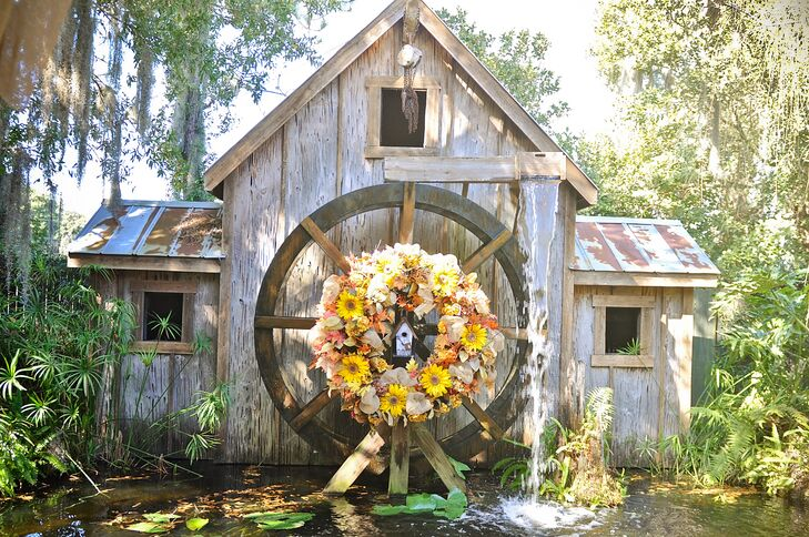 """As soon as I walked through the doors at Gigi's Country Garden, I knew I wanted to get married there. I didn't have to look anywhere else,"" Heather says. ""I remember standing where our ceremony would take place with a beautiful water mill as our backdrop and looking at my fiance and saying 'This is where we will start our forever.' "" The rustic mill was decorated with a wreath of sunflowers, burlap, and fall leaves. Since burlap was all over their reception, it was the perfect accent to tie everything together."