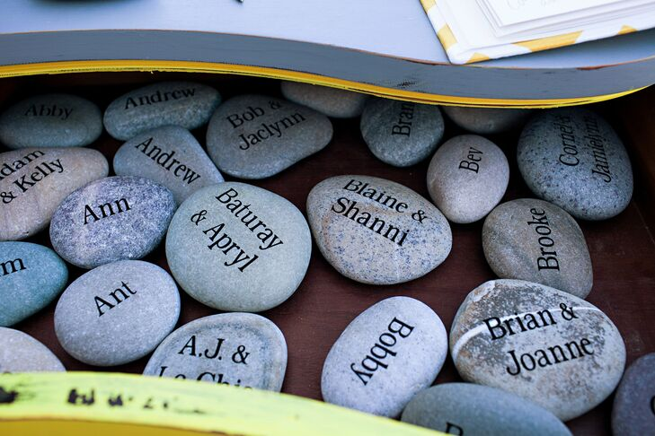 Rocks were engraved with guests' names; when they flipped the rocks over, they found a sticker with their table number.