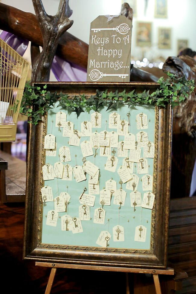 "As a place where their guests could leave well-wishes and wedding advice, the couple had an easel full of keys at their reception for their friends and family to leave the ""keys to a happy marriage."""