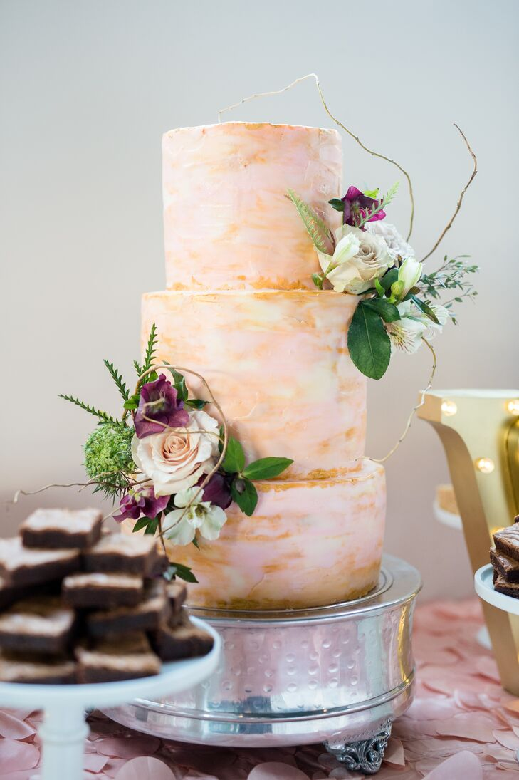 The Hungry Hero Dessert Company created a beautiful triple-layer cake in shades of pink.