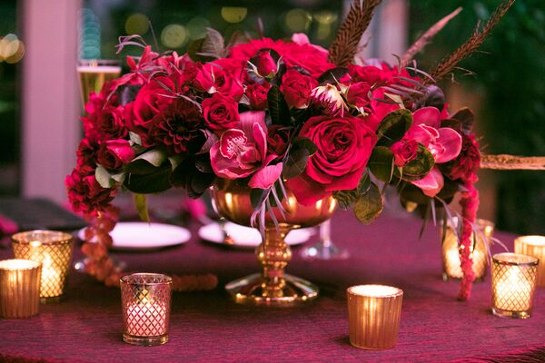 Low Burgundy Centerpiece With Feathers