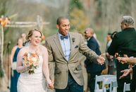Natalie Hogate (30 and a child life specialist) and Darren Griffith (32 and a real estate manager) used navy and soft shades of orange to accent their
