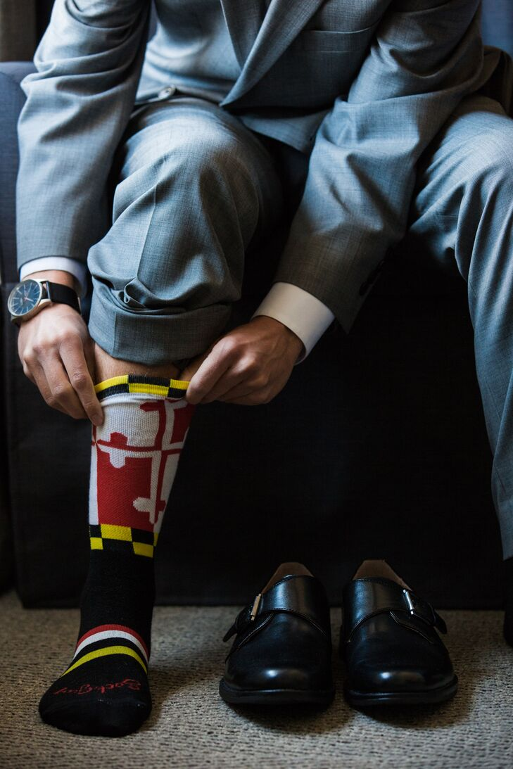 Groom Putting on Maryland Flag Socks