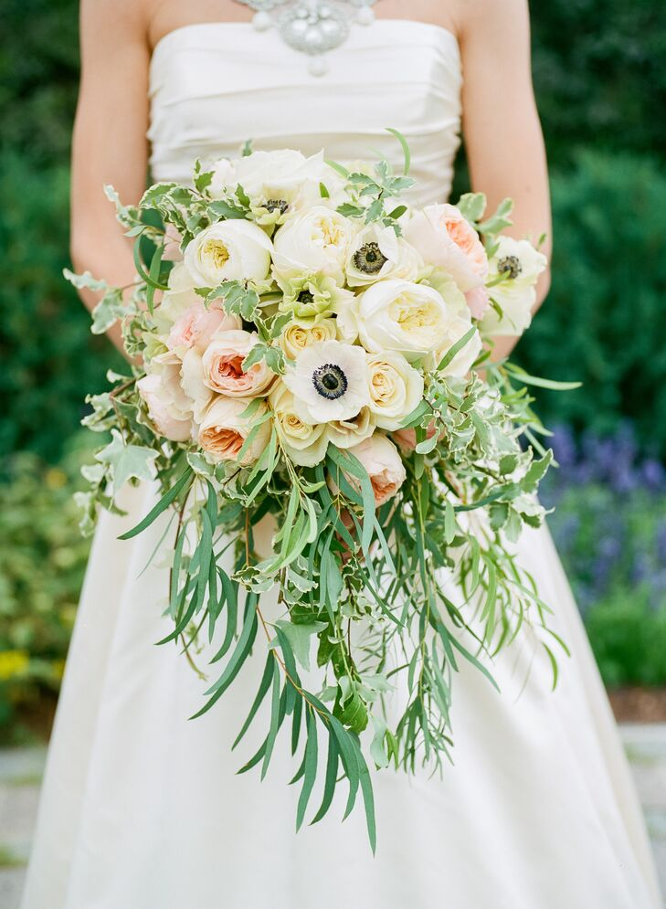 """In the picture of my great-grandmother on her wedding day, she is carrying a cascading bouquet. It is such a romantic look, and I felt it was perfect for my 'traditional with a twist' style,"" says Katie. Her bouquet included ivory and blush garden roses, ranunculus and anemones surrounded by lush greenery."