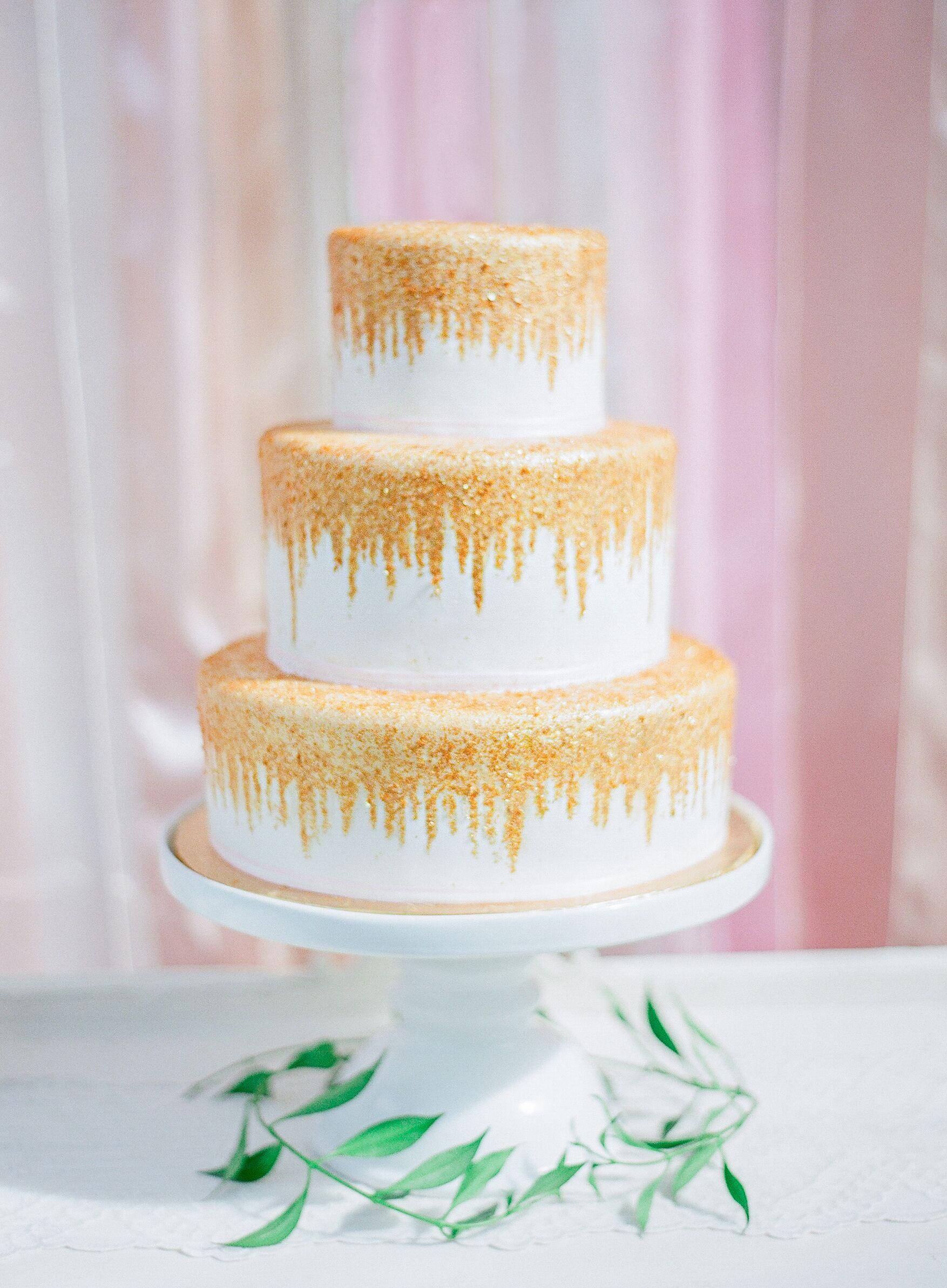 wedding cake. hand-painted gold glitter cake wedding