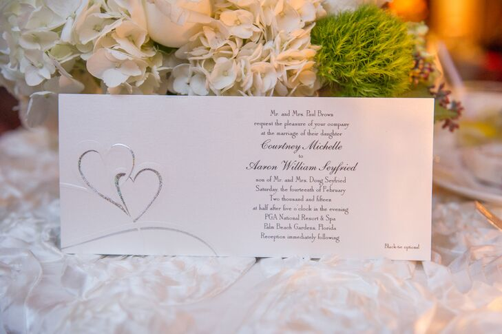 Courtney and Aaron turned a holiday devoted to love into their wedding day in just 15 months. Each of their 82 guests received a simple white invitation accented with two hearts.