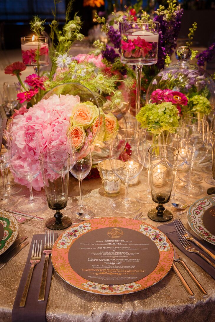 While the centerpieces themselves were noteworthy enough, silvery linens, colored glasses, floral china and plenty of candlelight upped the drama of each tablescape.
