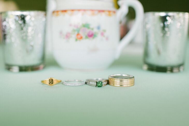 The couple opted for classic styles with a contemporary twist for their wedding bands. Lauren chose a simple diamond, white gold band to match her emerald engagement ring, while Carter selected a brushed, yellow gold band with polished etching.