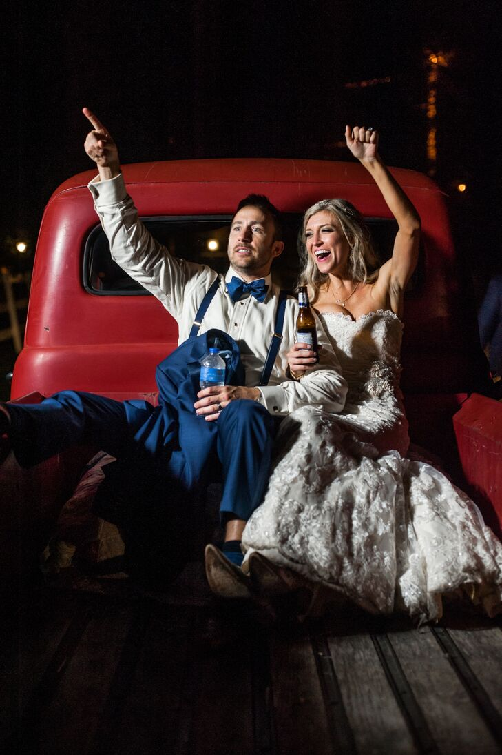 Courtney and Jeff hopped into a vintage red pickup truck at the end of the night.
