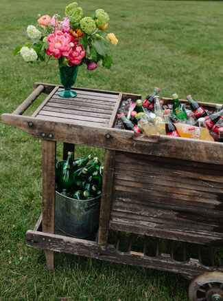Rolling drink cart for soda at wedding reception
