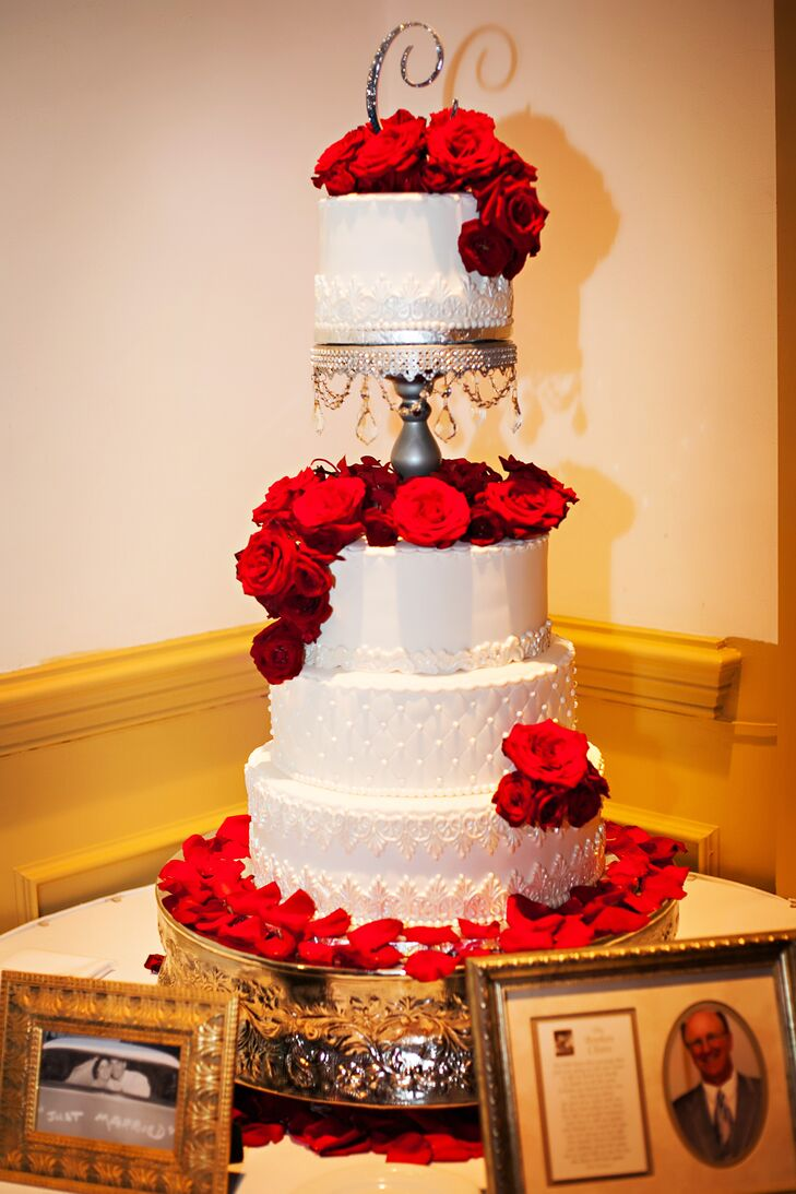 Four Tier White Wedding Cake With Red Roses