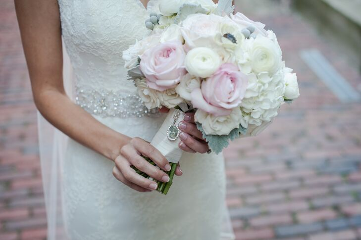 The bride carried a romantic bouquet filled with ivory ranunculus and hydrangea along with pink roses.