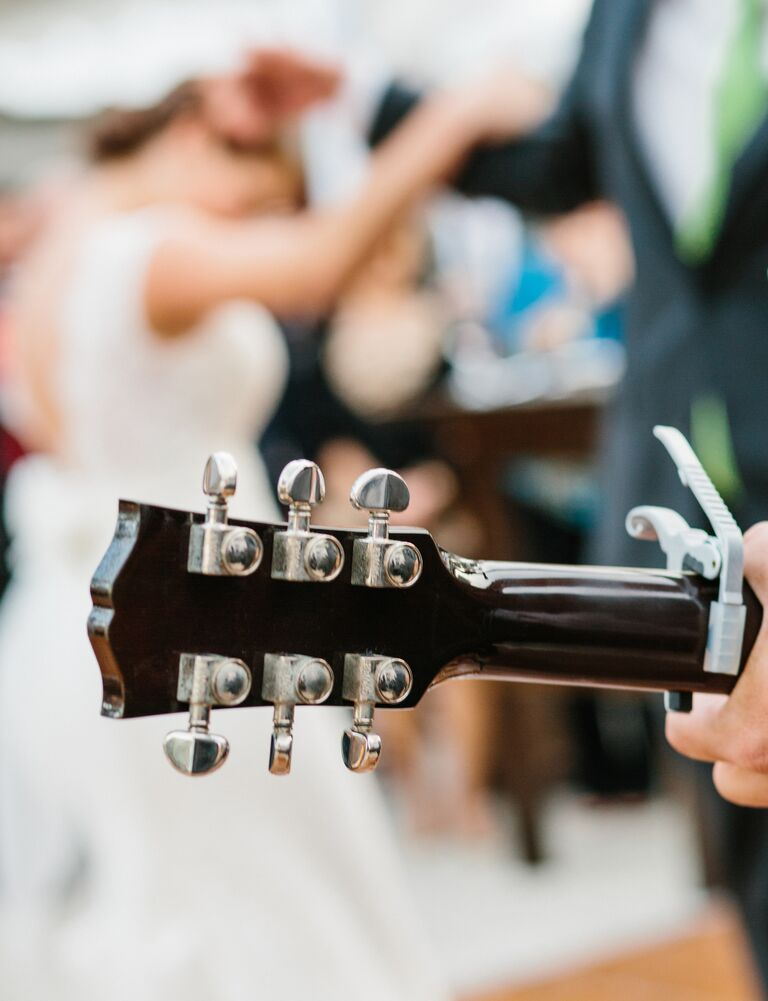 Bride and groom dance to wedding band