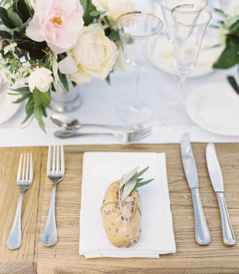 Sage and bread place setting with spring of herbs